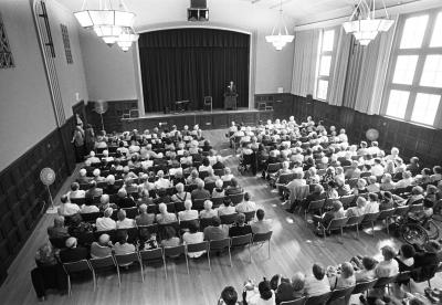 A full house of retirees at an early LIR program - black and white photo
