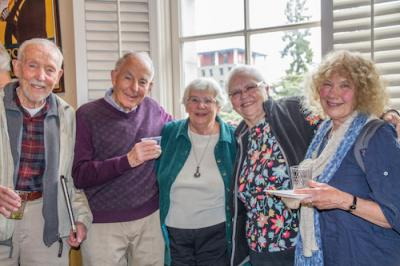 Book club members at a reception