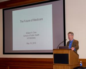 Professor William Dow presenting on the Future of Medicare